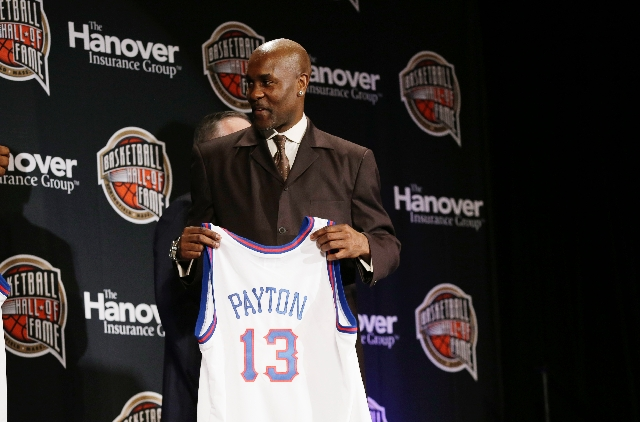 Gary Payton holds his commemorative jersey after being announced as a 2013 inductee to the Naismith Basketball Hall of Fame on Monday in Atlanta.