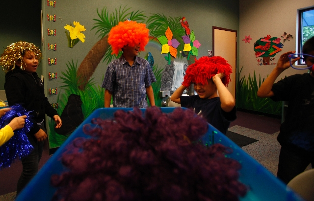 Children try on wigs during an acting class at the Cambridge Recreation Center.