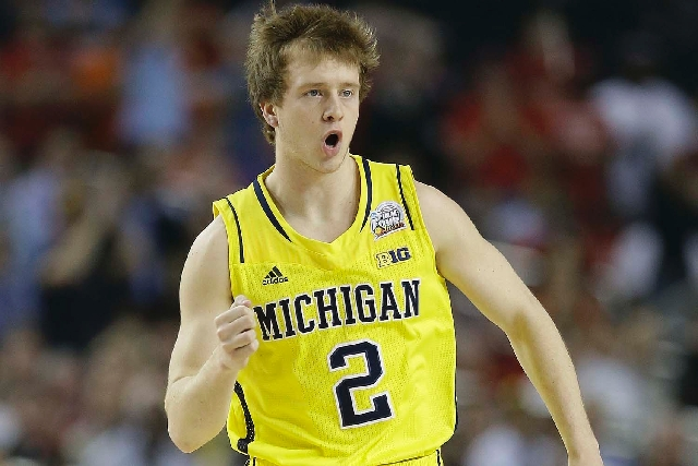 Michigan guard Spike Albrecht (2) reacts against the Louisville during the first half of the NCAA Final Four tournament college basketball championship game Monday in Atlanta.