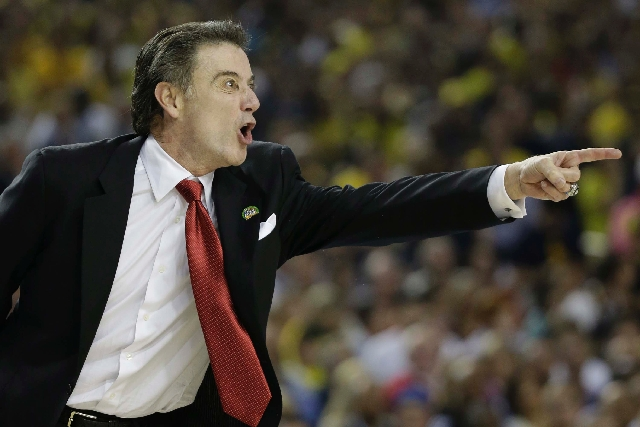 Louisville  head coach Rick Pitino reacts on the sideline against the Michigan during the first half of the NCAA Final Four tournament college basketball championship game Monday in Atlanta.