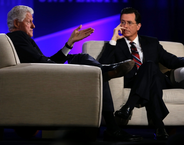 This April 6 file photo shows former President Bill Clinton, left, and Comedy Central's Stephen Colbert during the Clinton Global Initiative at Washington University in St. Louis. More than  ...