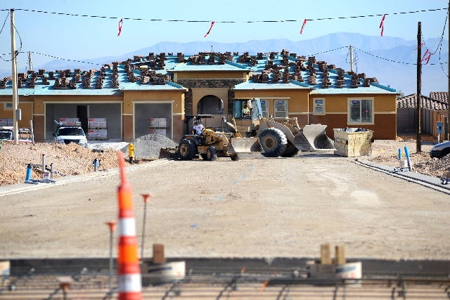 Workers grade the streets in front of new-home construction in the Durango Ranch subdivision in southwest Las Vegas. Strong demand and a tight housing supply continue to push up Las Vegas home pri ...