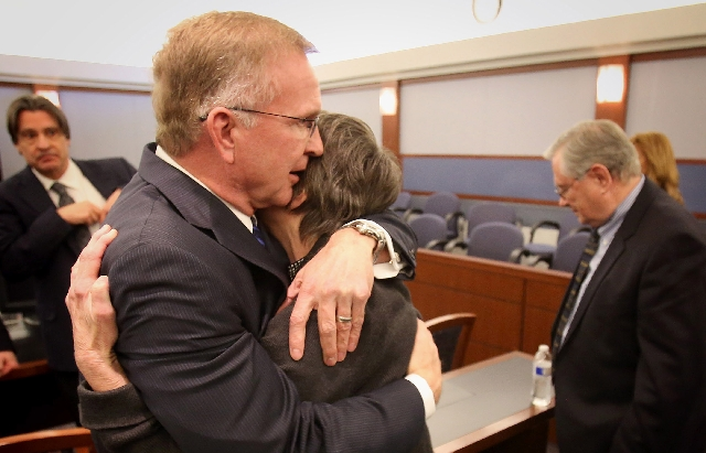Attorney Robert Eglet, left, embraces Bonnie Brunson, 70, while her husband Carl, right , 71, stands after the hepatitis C punitive damages verdict Tuesday in Clark County District Court.