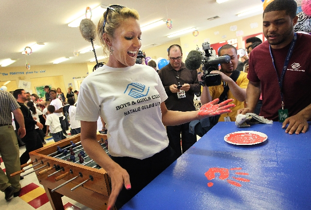 Pro golfer and Henderson resident Natalie Gulbis makes her official handprint Tuesday at the opening of a new Boys & Girls Club at the Apache Pines apartments.