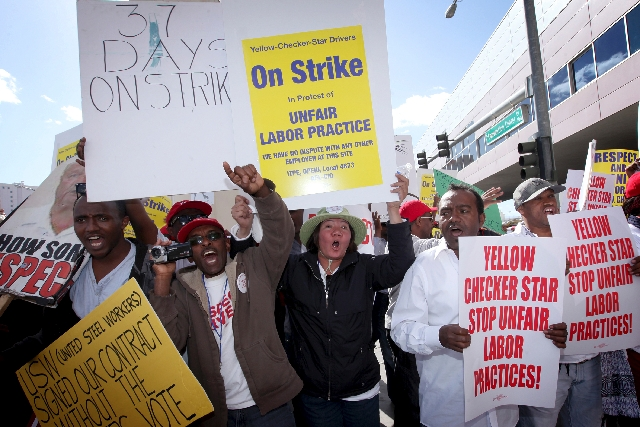 Cab drivers for Yellow Checker Star Transportation, now in their sixth week of a strike, take their dispute to the Las Vegas Convention Center on Tuesday. The time was chosen to try to dissuade th ...