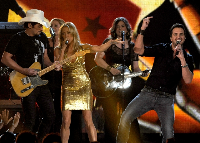 Brad Paisley, left, and Sheryl Crow perform Sunday with Luke Bryan at the Academy of Country Music Awards at the MGM Grand Garden.