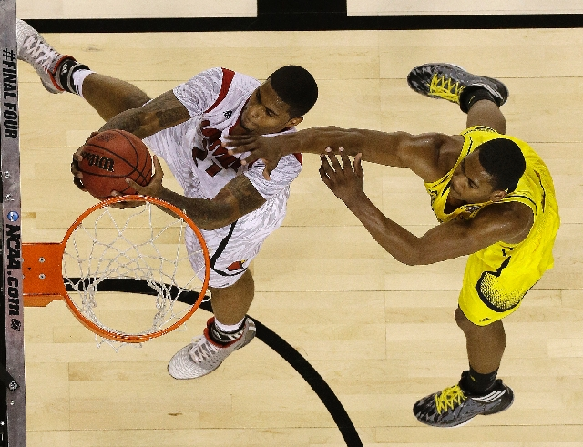 Louisville forward Chane Behanan goes to the basket against Michigan forward Glenn Robinson III in the second half of the Cardinals' victory Monday in the NCAA title game.