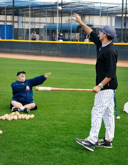 College of Southern Nevada baseball team manager Matt Cutler, left, tosses a ball to Coyotes assistant coach Sean Larimer during practice at Morse Stadium in Henderson. Cutler, who has Down syndro ...