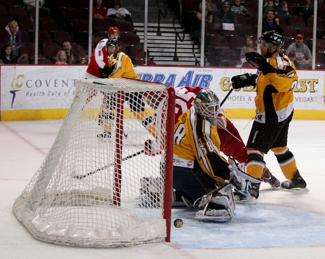 Wranglers left wing Andrew Sarauer (25) scores a goal past Thunder goalie Olivier Roy in Game 5 of their ECHL conference quarterfinal playoff series Wednesday night at Orleans Arena.