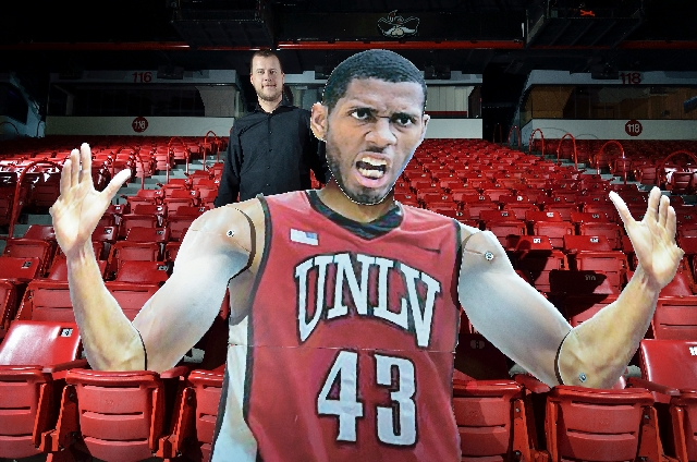 Sean Clauretie —that's him in back —looks over the shoulder of his elaborate Mozilla cutout of former UNLV basketball player Mike Moser last week at the Thomas & Mack ...
