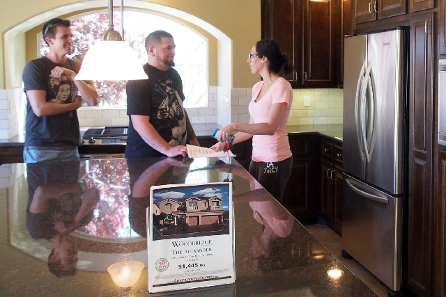 Eric Wennerberg, left, and sister Emily talk to their friend John Siemer as they tour homes in American West's Woodbridge at the Coronado Ranch subdivision Friday. Siemer is looking for a ne ...