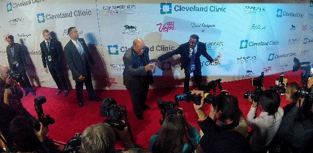 Honoree Quincy Jones, middle, poses for press photographers Saturday during the red carpet for Keep Memory Alive's 17th annual Power of Love Gala at the MGM Grand. Jones' career spans  ...