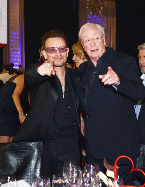 Bono enjoyed a moment with Michael Caine at the Keep Memory Alive/Power of Love benefit gala Saturday at the MGM Grand Garden.