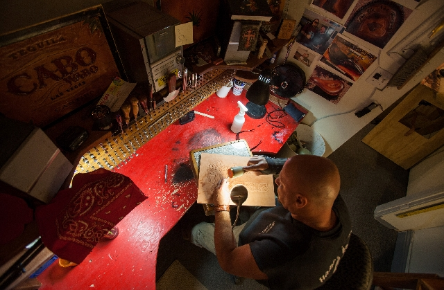 Steve Gilworth works in his studio, April 15. He hopes to soon open a new location downtown near The Arts Factory.
