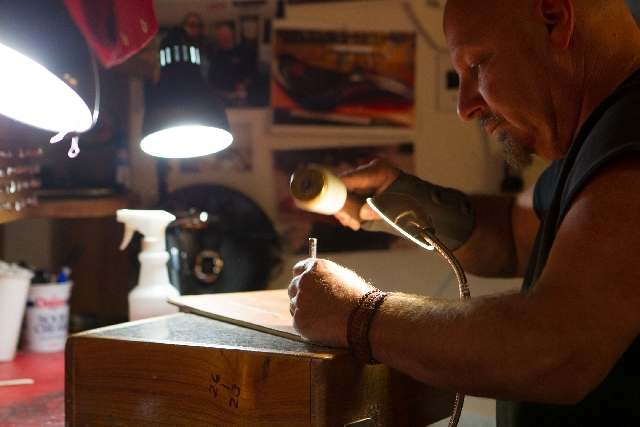 Leather crafter Steve Gilworth works on a leather road case insert at his studio, Hammered Hide Leatherworks, inside Count's Kustoms at 2714 S. Highland Drive, April 15. Gilworth regularly appears ...