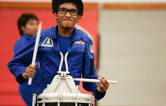 Raymond Lopez, 19, plays the snare drum during a Vegas Vanguard Percussion dress rehearsal and program run-through at UNLV Friday, April 12. The indoor drumline team plans to compete at the Percus ...