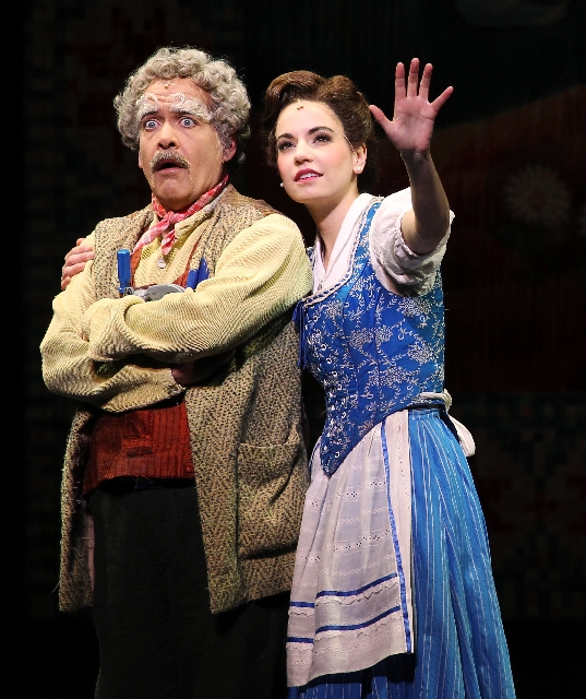 """Hilary Maiberger as Belle and William A. Martin as her father, Maurice, perform during a scene from the musical """"Beauty and the Beast"""" at The Smith Center Tuesday evening."""
