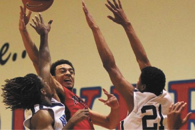 Nigel Williams-Goss, center, is Findlay Prep's first four-year player and the Pilots' seventh McDonald's All-American.