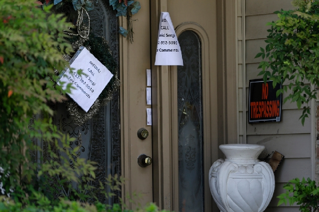 A printed sign on the door of the home of Eric Lyle Williams directs media to a spokesperson for the Williams family in Kaufman, Texas, on Monday. Texas authorities have arrested the former justic ...