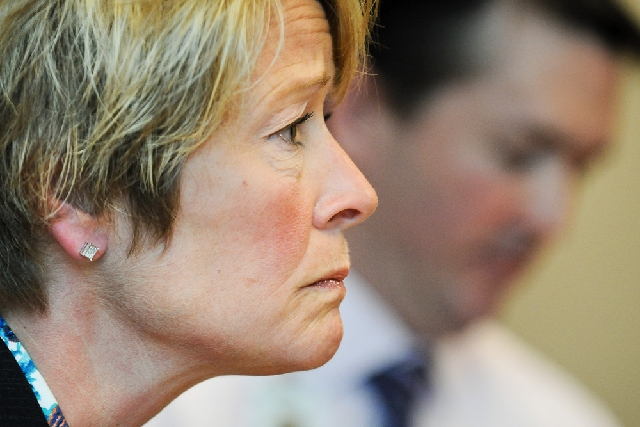 Chris Boese, chief nursing officer and vice president of patient care at Regions Hospital, listens to a reporter's question during a news conference at the hospital in St. Paul, Minn., on We ...