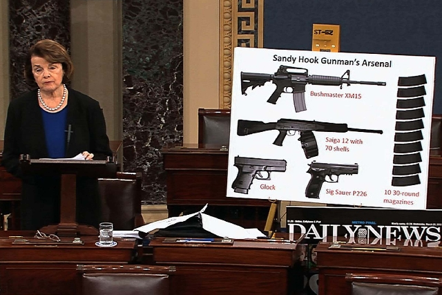 This video frame grab provided by Senate Television shows Sen. Dianne Feinstein, D-Calif. using a poster of weapons as she speaks about gun legislation on Wednesday on the floor of the Senate on C ...
