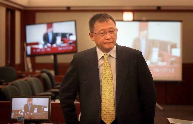 Businessman Richard Suen is seen Wednesday at the Regional Justice Center. He says Las Vegas Sands Corp. owes him $328 million for his help in securing a subconcession in Macau.