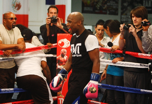 Floyd Mayweather Jr. gets ready to work out in preparation for his upcoming fight against Robert Guerrero .