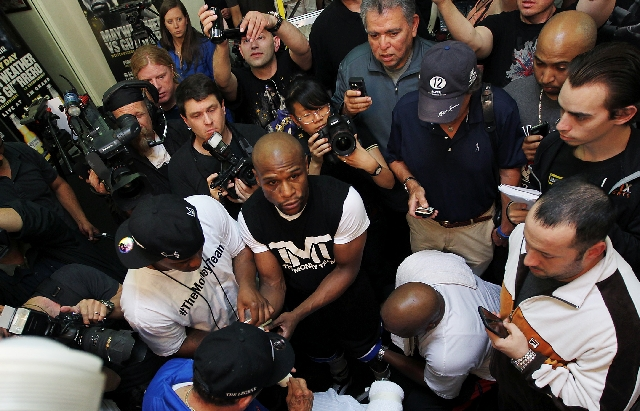 Floyd Mayweather Jr. is the center of attention Wednesday at his Las Vegas boxing club.