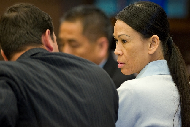 Catherine Kieu sits next to her attorney, deputy public defender, Frank Bittar, before opening statements Wednesday in Santa Ana, Calif.  Kieu is charged with cutting off a man's penis and t ...