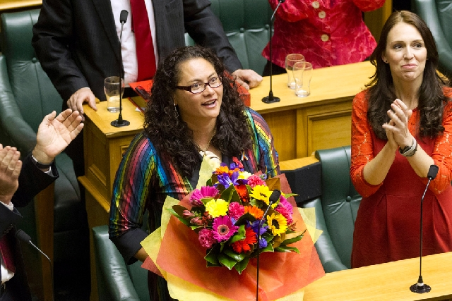 New Zealand lawmaker Louisa Wall, center, who sponsored the gay marriage bill is congratulated by MP Jacinda Ardern after the Marriage Amendment Bill was passed at Parliament in Wellington, New Ze ...