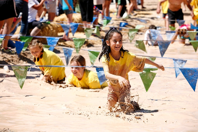 Children slosh through the mud pit at a previous Mudpuppy Splash, which is a race just for kids. This year the event will be held April 27 at Providence's Knickerbocker Park.