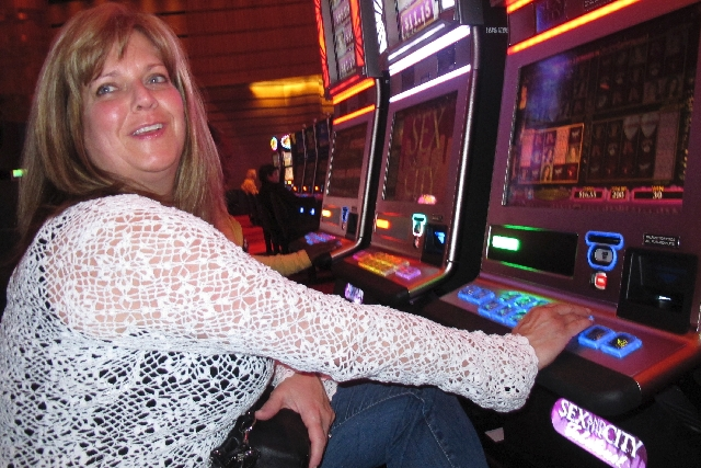 "Donna Kiddie of Point Pleasant Beach, N.J., plays a ""Sex And The City"" slot machine at Revel in Atlantic City in 2012. A bankruptcy court judge on Thursday gave final approval to a $250 million te ..."