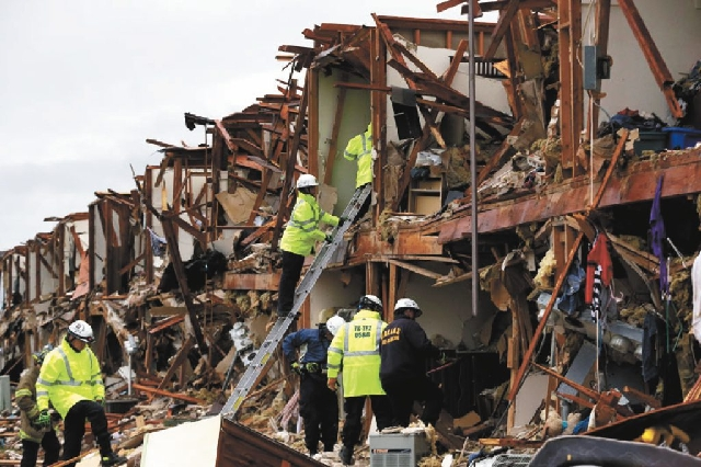 Firefighter conduct search and rescue of an apartment Thursday destroyed by an explosion at a fertilizer plant in West, Texas, on Wednesday night.