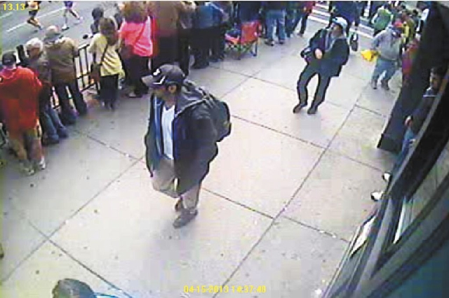 The FBI is seeking these two suspects, suspect No. 1 in the black hat and suspect No. 2 in the white hat, in the bombing at the Bostom Marathon on Monday.