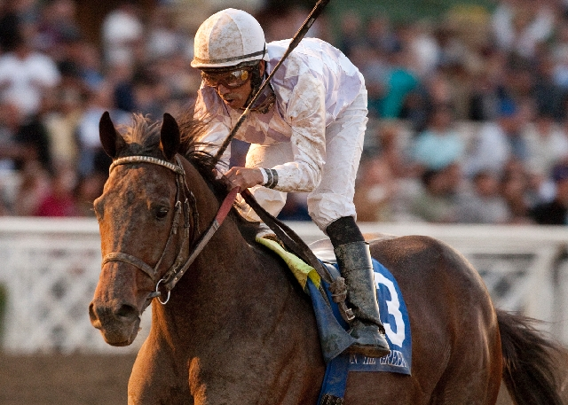 Ron the Greek, ridden by Jose Lescano, crosses the line to win the Santa Anita Derby on March 3, 2012, at Arcadia, Calif. At 5-2 odds, Ron the Greek is the second choice behind Game On Dude (4-5)  ...
