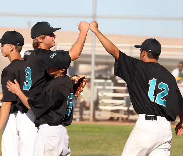 Silverado senior pitcher David Kuzma, left, fist-bumps senior teammate Thomas Licea after the final out of the Skyhawks' 3-1 victory over visiting Rancho on Thursday.