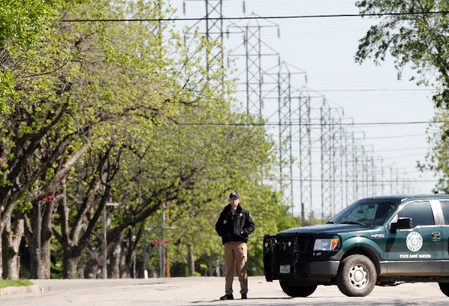 A Texas Game Wardon guards a closed road in West, Texas on Friday. The bodies of 12 people have been recovered after an enormous Texas fertilizer plant explosion that demolished surrounding neighb ...