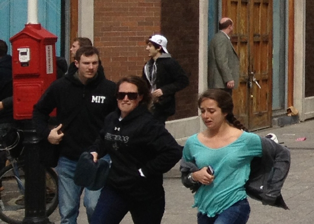 This Monday shows a man who was dubbed Suspect No. 2 in the Boston Marathon bombings by law enforcement, in the upper center of the frame, wearing a white baseball cap, walking away from the scene ...