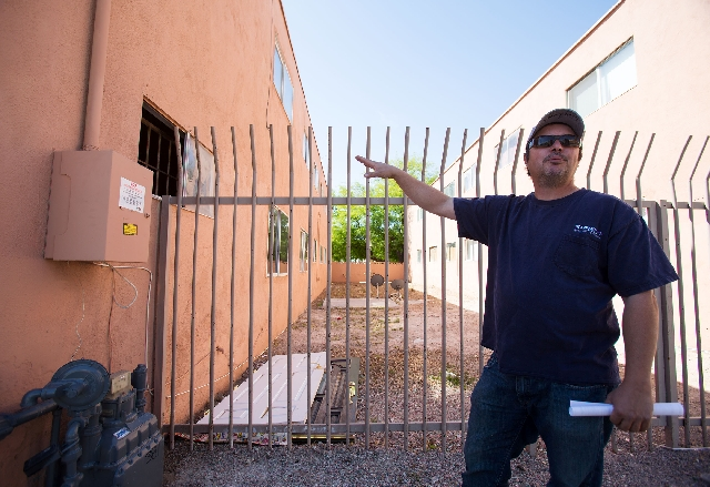 Condominium owner Malcolm Perez talks about problems at the complex on Silver Dollar Avenue, including deferred maintenance, graffiti, broken mailboxes, a closed laundry room and illegal drug deals.