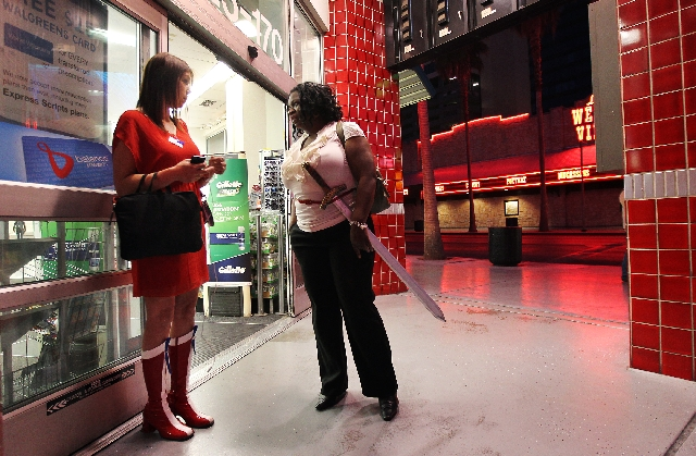 Necole Zeigler, left, wearing Wonder Woman boots, talks with Felesia Wade, who is working on a Xena Warrior Princess costume for a fundraiser May 11 at Neonopolis on Fremont Street. They hope 1,58 ...