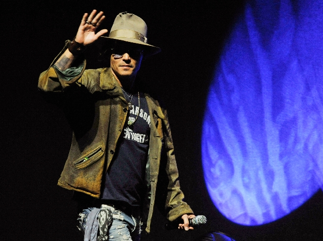 """Johnny Depp, who plays Tonto in the upcoming film """"The Lone Ranger,"""" makes a surprise appearance Wednesday at the Walt Disney Studios presentation at CinemaCon 2013 at Caesars Palace."""