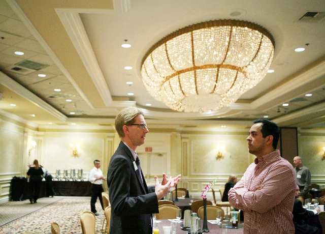 Tim Evans, QVegas Business Alliance board member, left, and Cesar Chacon, account manager at LV Photo, talk at the National Gay & Lesbian Chamber of Commerces session at the Monte Carlo on Friday.