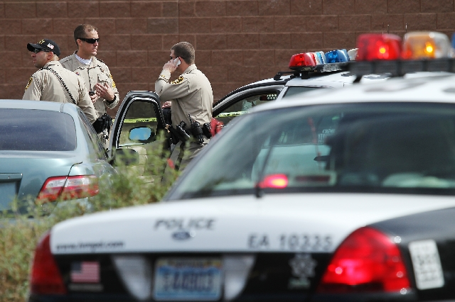 Metro Police respond to a call on the 10000 block of Wolf Pack Lane in Las Vegas on Friday.