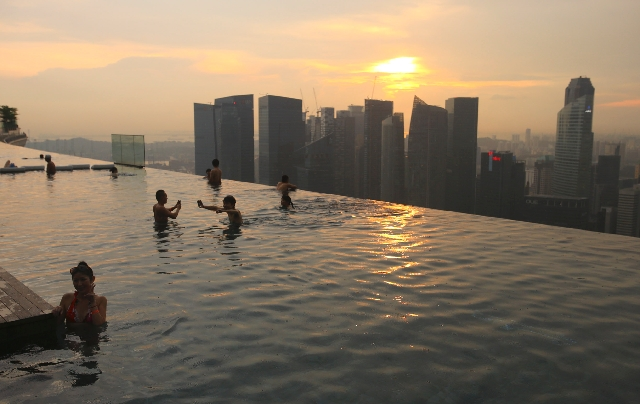 People swim at the pool at the SkyPark at Marina Bay Sands Singapore on Nov. 27. Singapore regulators renewed Las Vegas Sands Corp.'s license Friday, letting the company operate Marina Bay Sands f ...