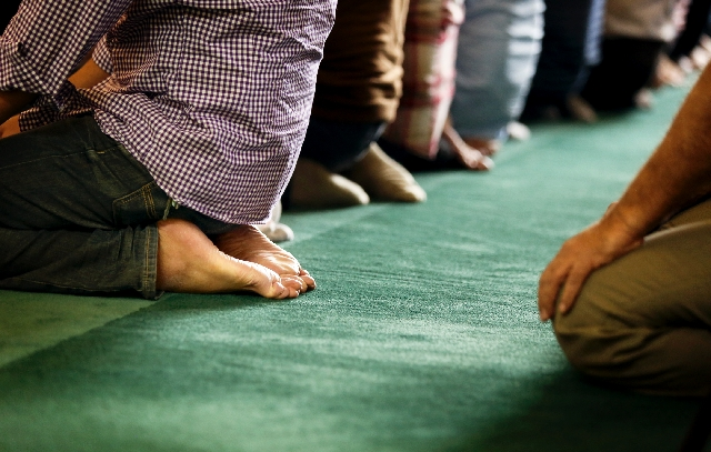 Men pray Friday afternoon at the Islamic Society of Nevada mosque.