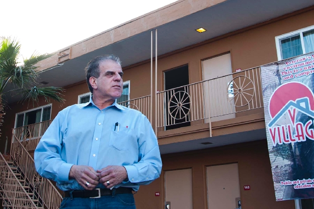 Arnold Stalk walks the grounds of Veterans Village, a former motel converted into temporary housing for homeless veterans at 1150 Las Vegas Blvd. South. During the next three years, Stalk hopes to ...