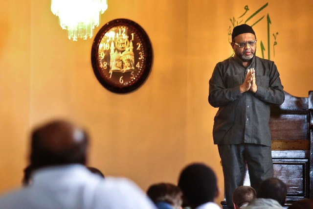 Aslam Abdullah, director of the Islamic Society of Nevada, delivers a sermon Friday at the society's mosque at 4730 E. Desert Inn Road. Abdullah discussed the perils imposed on Muslims when acts o ...