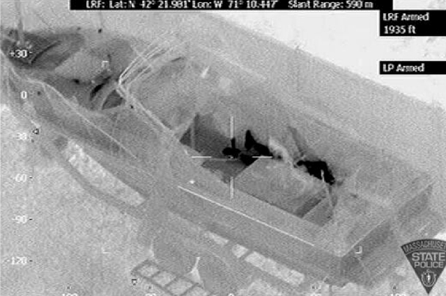 This Friday image made available by the Massachusetts State Police shows 19-year-old Boston Marathon bombing suspect, Dzhokhar Tsarnaev, hiding inside a boat during a search for him in Watertown,  ...