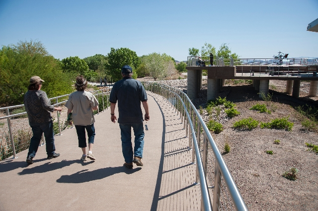 Visitors walk the grounds at the new Nature Center at the Clark County Wetlands Park on Saturday. The 45,000-square-foot complex also features an 85-seat auditorium and information center at the p ...