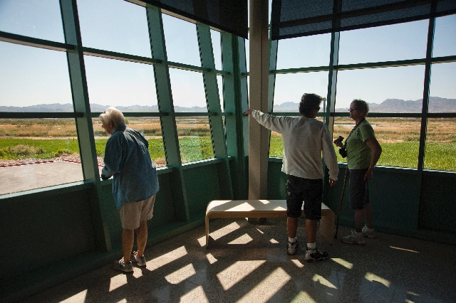 Visitors examine the wetlands during the grand opening and dedication of the new Nature Center at the Clark County Wetlands Park on Saturday. The 45,000-square-foot complex also features an 85-sea ...